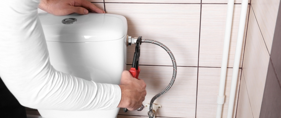 Toilet repairs being performed by a plumber in Valrico, FL.