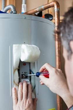 Curtis Plumbing repairing a water heater in Riverview, FL.